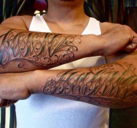 Tatouage homme bras ecriture